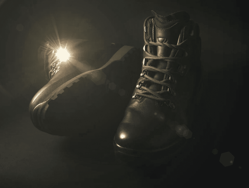 brown work boots with a lens flare
